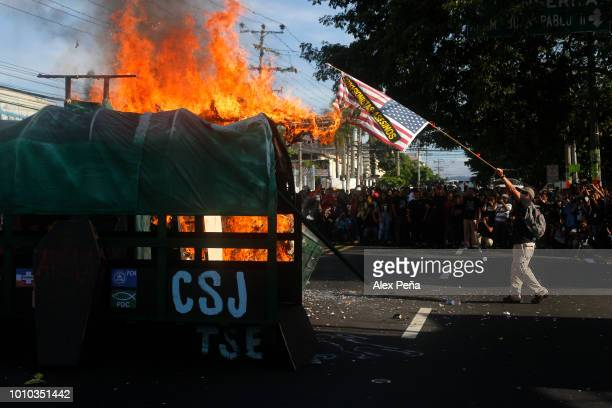 Students burn a United States flag during a protest on July 30 2018 in San Salvador El Salvador Hundreds of students demonstrate against the...