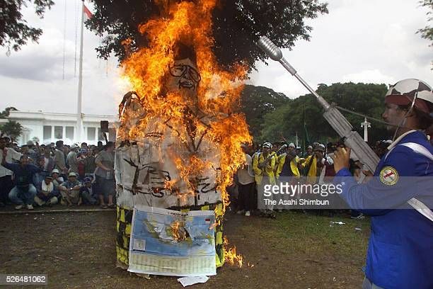 Students burn the effigy of President Abdurrahman Wahid during a rally on March 12 2001 in Jakarta Indonesia