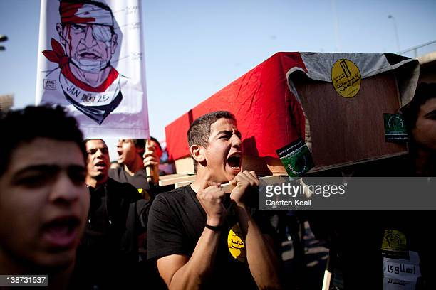 Students carry a symbolic coffin in rememberance for student who was killed in Port Said during the recent football match clashes on February 11 2012...