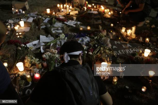 Students carry candles during a protest demanding Nicaraguan President Daniel Ortega and his wife Vice President Rosario Murillo to step down in...