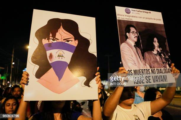 Students carry posters during a protest demanding Nicaraguan President Daniel Ortega and his wife Vice President Rosario Murillo to step down in...