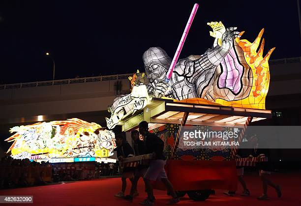 Students carry the Star Wars Sith Nebuta float featuring Darth Maul, Sheev Palpatine and Darth Vader during the eve of the Nebuta summer festival in...