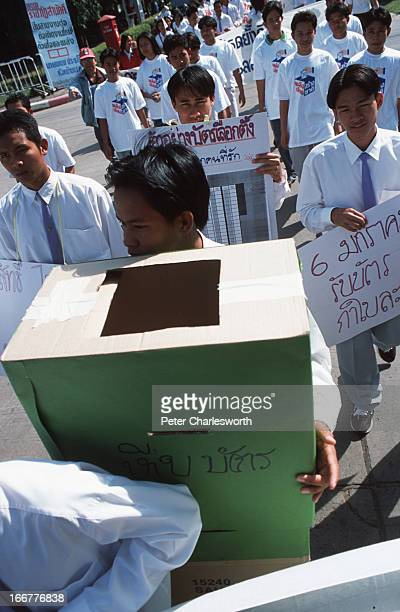 Students carrying a mockup ballotbox campaign for a clean and fair General Election They hope to educate the electorate about not accepting money for...