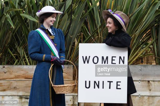 Students Cassie Dickson and Rosa Higgs pose with placards while they recreate a suffragette protest march through the town centre at Royal Holloway...