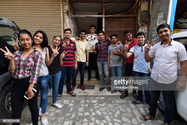 Students celebrate after Central Board of Secondary Education announced the results of Class 10 board examinations at Patel Nagar on May 29 2018 in...