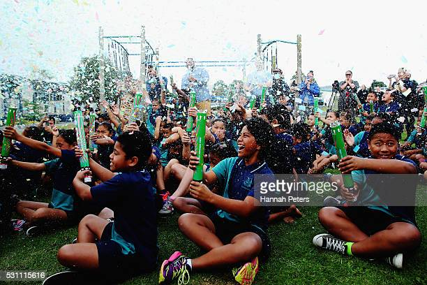 Students celebrate as the Tesla Powerwall battery is turned on at Rongomai School on May 13 2016 in Auckland New Zealand The Powerwall and solar...
