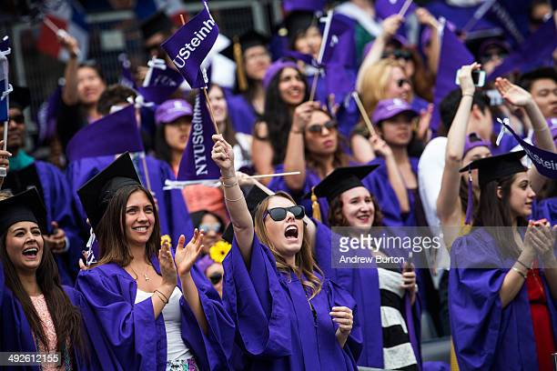 Students celebrate at the commencement of the 2014 New York University graduation ceremony at Yankee Stadium on May 21 2014 in the Bronx borough of...