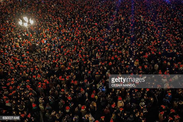 Students celebrate during the traditional yearend party held in the main square of Salamanca Spain on December 15 2016 The student end of year party...
