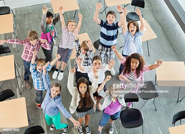 Students celebrating in classroom