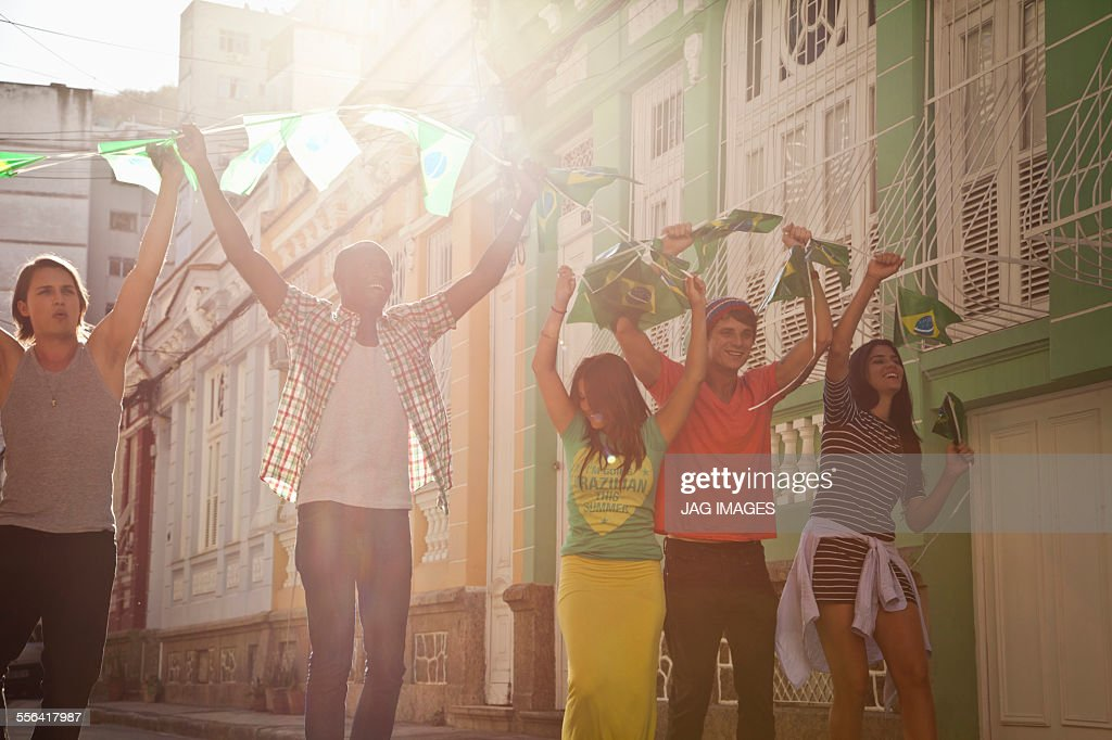 Students celebrating with Brazilian flags in the street, Rio de Janeiro, Brazil : Stock Photo