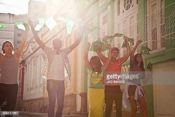 Students celebrating with Brazilian flags in the street, Rio de Janeiro, Brazil