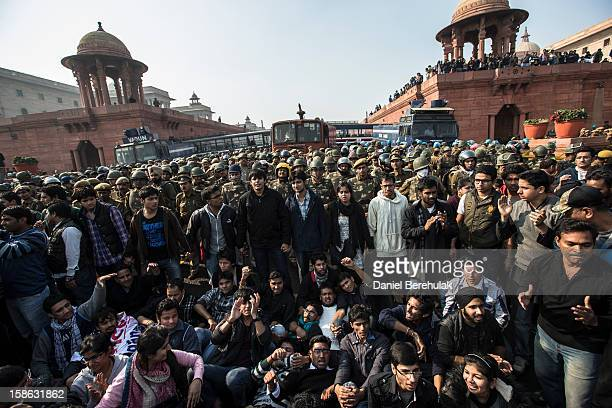 Students chant antipolice slogans as they form a line in front of cordon of Police dressed in riot gear during a protest against the Indian...