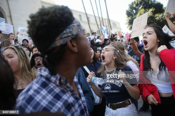Students chant as they participate in a rally for National School Walkout Day to protest school violence on April 20 2018 in Los Angeles California...