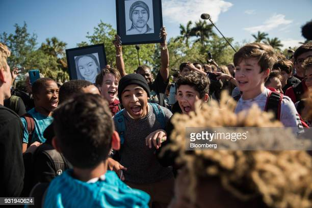Students chant outside Marjory Stoneman Douglas High School during the ENOUGH National School Walkout rally in Parkland Florida US on Wednesday March...