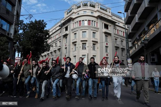 Students chant slogans as they take part in a 24hour general strike in Athens on December 14 2017 The strike has paralysed the civil service trains...