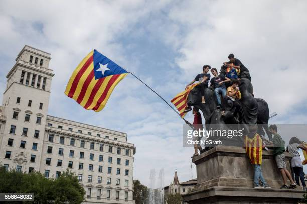 Students chant slogans during a protest against the violence that marred yesterday's referendum vote at Placa de Catalunya on October 2 2017 in...
