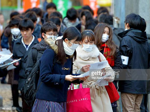Students check application cards prior to the national center exams at Tokyo University on January 17, 2015 in Tokyo, Japan. 559,132 who wish to...