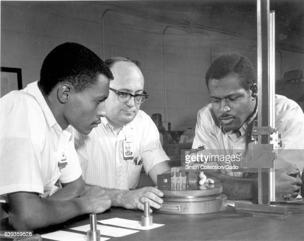 Students check the quality of a machine in an inspection laboratory Oak Ridge Tennessee 1970 Image courtesy US Department of Energy