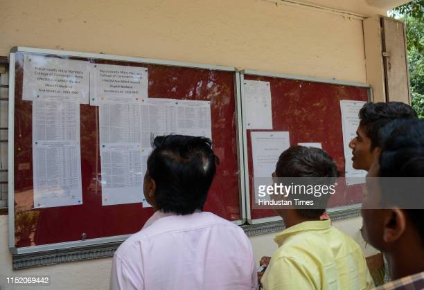 Students checking their names into a list at MMCC College, on June 25, 2019 in Pune, India.