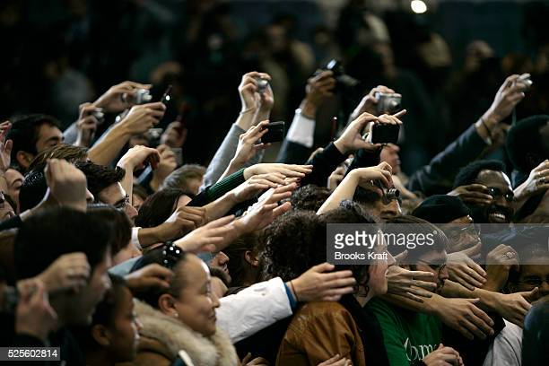 Students cheer as Democratic presidential hopeful Barack Obama arrives with Senator Edward Kennedy for a rally at American University in Washington...