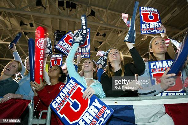Students cheer as Democratic presidential nominee Senator John Kerry of Massachusetts speaks to an audience at the University of New Hampshire