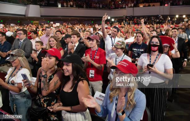 Students cheer as US President Donald Trump speaks during a Students for Trump event at the Dream City Church in Phoenix, Arizona, June 23, 2020.