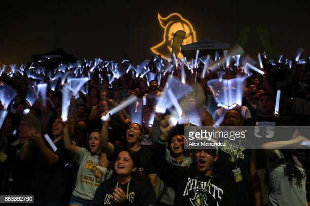 UCF students cheer with light sticks during a NCAA basketball game between the Missouri Tigers and the UCF Knights at the CFE Arena on November 30...
