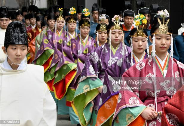 Students clad in special costumes head for a Shinto shrine at Kokugakuin University during a traditional adulthood ceremony in Tokyo on January 20...