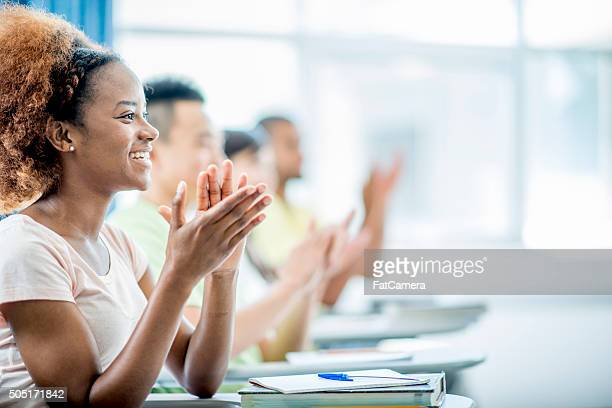 Students Clapping After a Lecture