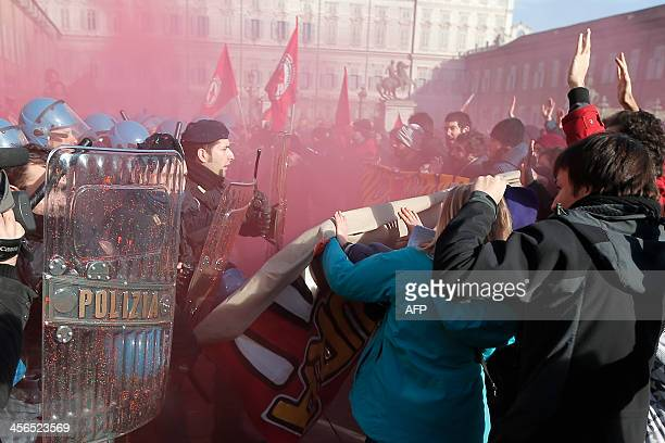 Students clash with police during a protest against the local government in downtown Turin on December 14, 2013. Protesters clashed with police...
