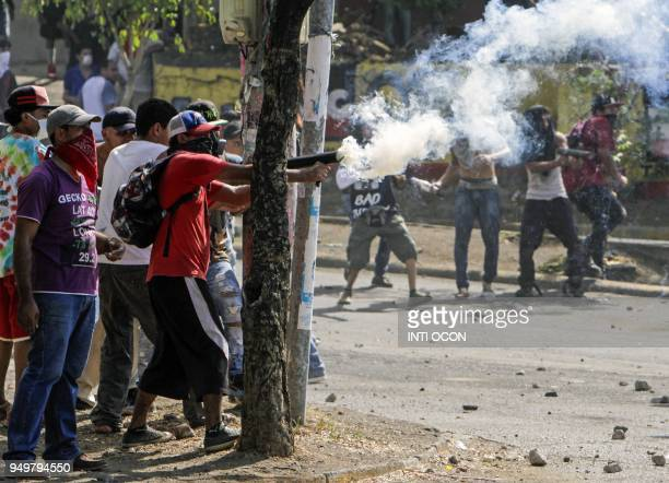 TOPSHOT Students clash with riot police agents close to Nicaragua's Technical College during protests against government's reforms in the Institute...