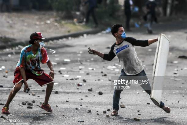 Students clash with riot police agents during protests against government's reforms in the Institute of Social Security in Managua on April 21 2018...