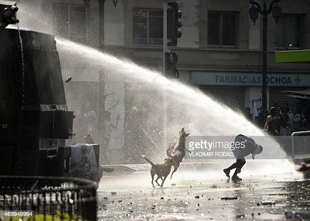 Students clash with riot police during a demonstration demanding the Chilean Government for better education conditions in Santiago on April 16 2015...