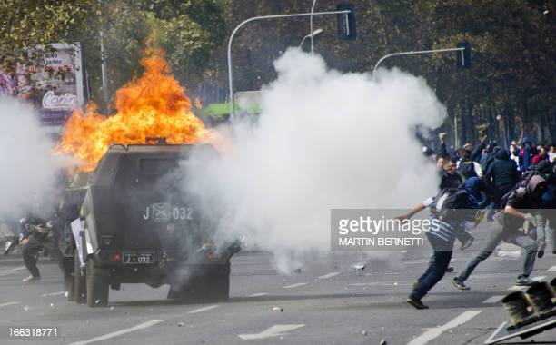 Students clash with riot police during a protest to demand Chilean President Sebastian Pinera's government to improve the public education quality in...