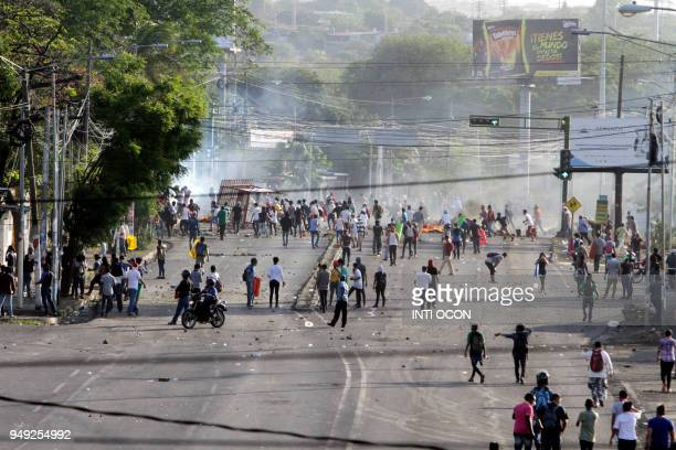 Students clash with riot police in front of the Engineering University during a protest against the government's reforms in the Institute of Social...