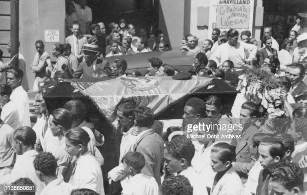 Student's coffin is carried through the streets after riots in Caracas, Venezuela, 11th February 1937. The victim is said to be the illegitimate son...