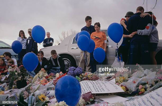 Students comfort each other while gathered at a memorial for the victims of the Columbine shooting In May of 1999 students Eric Harris and Dylan...