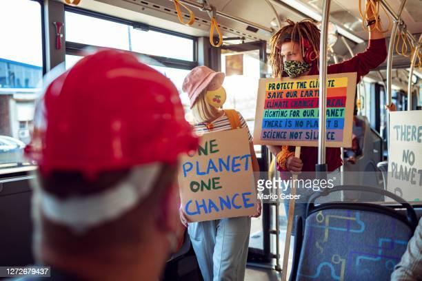 students commuting in a bus - activista fotografías e imágenes de stock