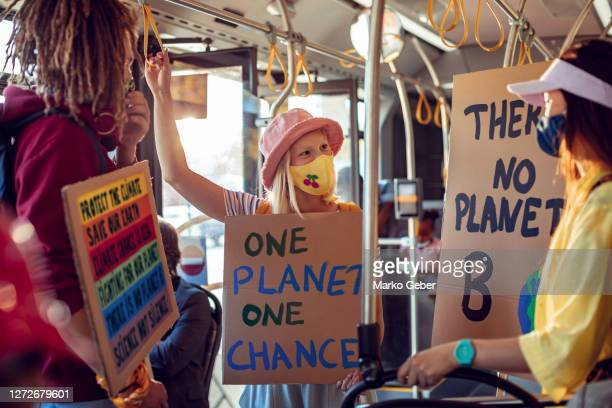 students commuting in a bus - protestor stock pictures, royalty-free photos & images