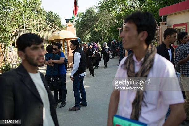 Students congregate outside a gate at the end of classes May 14, 2013 on the campus of Kabul University in Kabul, Afghanistan. Kabul University is...