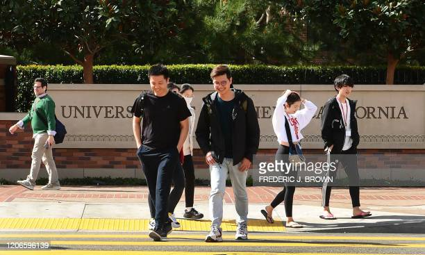 Students cross a crosswalk at the University of Southern California in Los Angeles California on March 11 where a number of southern California...