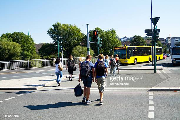 Students crossing junction and crosswalk