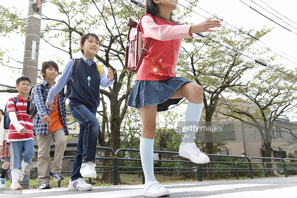 Students crossing street : Stock Photo