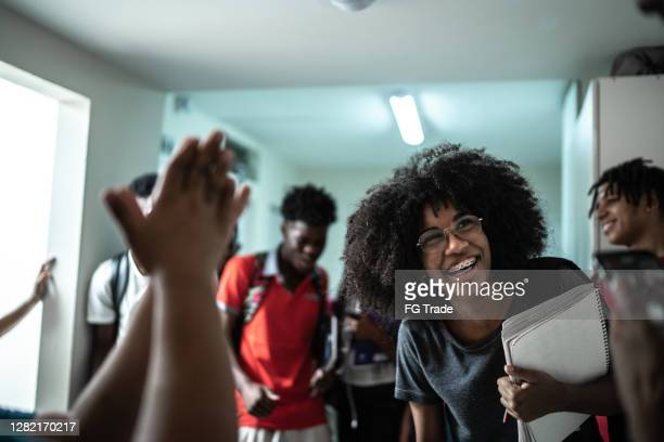 students dancing /celebrating in the university corridor - 18 19 years stock pictures, royalty-free photos & images