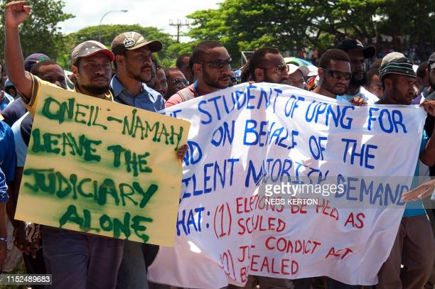 Students demand suffrage as thousands of Papua New Guineans protest against the government's plan to delay national elections during a rally in Port...
