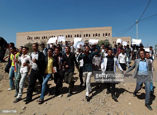Students demonstrate against the deployment at Sanaa University campus of armed Yemani militia from the Shi'ite Huthi movement in the capital Sanaa...