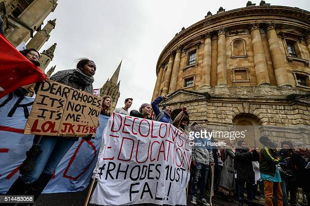 Students demonstrate outside Oxford University's All Souls College where a staute of Christopher Codrington is based which they are campaigning to be...