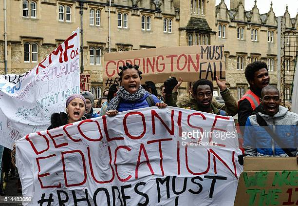 Students demonstrate outside Oxford University's Oriel College where a staute of Cecil Rhodes is based which they are campaigning to be removed from...