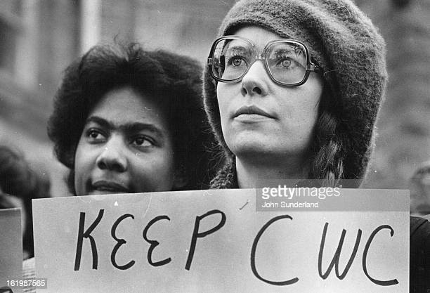 JAN 5 1981 JAN 6 1981 CWC students Denise Alexis left and Karen Fisher right listen to speakers during a noontime rally in front of the school's...