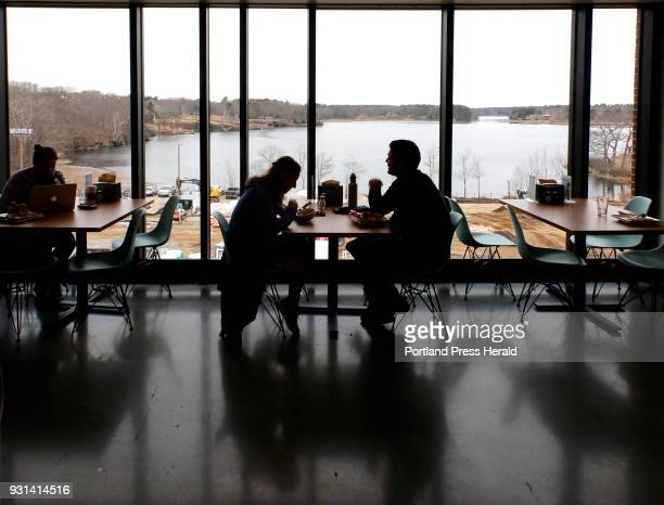 Students dine next to sprawling views of Saco RIver through birdproof glass at University of New England's newly dedicated Danielle N Ripich Commons...